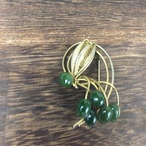 Vintage green and gold antique gold pin